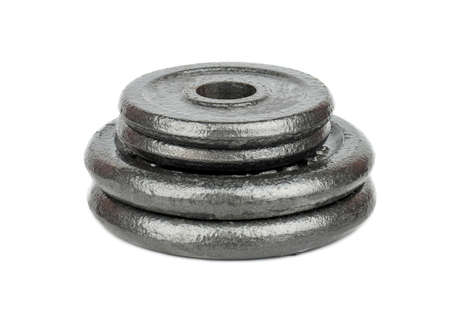 body toning: Stack of weight plates isolated on white background