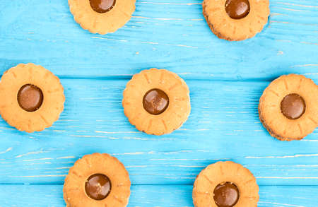 Cookies with condensed milk on a blue wooden background, top view