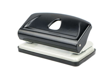 punch press: Black office hole punch for paper on a white background