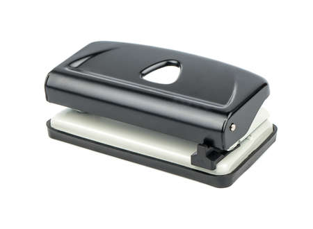 paper punch: Black office hole punch for paper on a white background