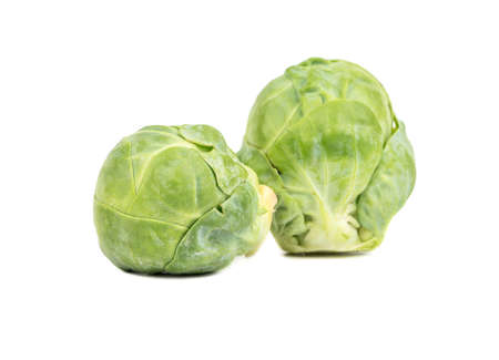 brussel: Two raw brussel sprouts on a white background