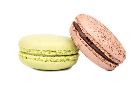 Pistachio and chocolate macaroon isolated on white background
