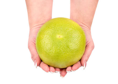 Fresh fruit sweetie Oroblanco in female hands on a white background