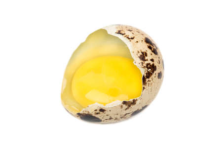 Raw broken quail egg isolated on white background