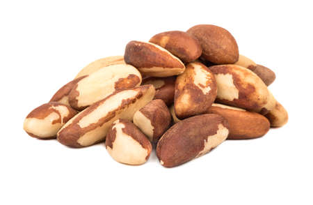 Bunch of raw Brazil nuts on white background Imagens
