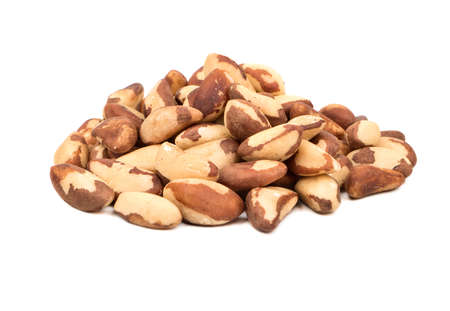 Large pile of raw Brazil nuts on white background Stock Photo