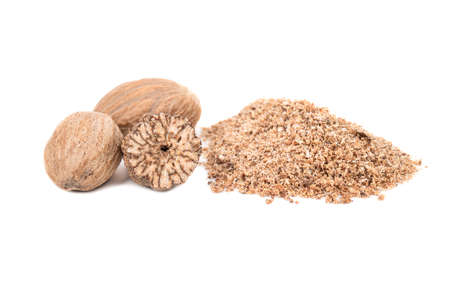 Nutmeg powder, and three nuts on white background