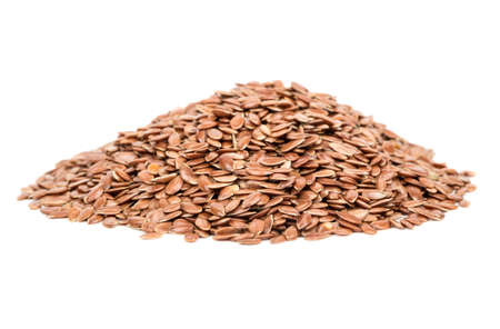 Bunch of raw flax seeds isolated on white background Stock Photo