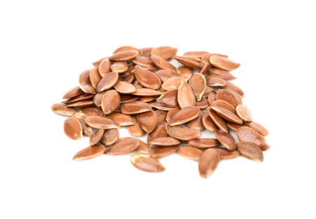 Several raw flax seeds on a white background Banque d'images