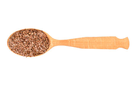 Flax seeds in wooden spoon isolated on white background, top view Stock Photo