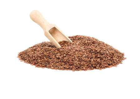 Bunch of flax seeds and wooden scoop on white background