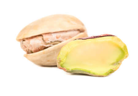 Salted pistachio nut with half on a white background 版權商用圖片