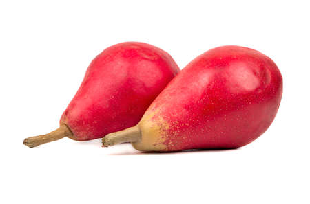 autumn colour: Two ripe red fruit pears on a white background closeup Stock Photo