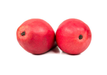 autumn colour: Two tasty red fruit pears isolated on a white background