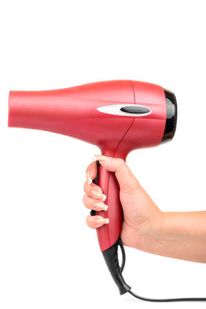 dryer: Pink hair dryer in the female hand on white background Stock Photo