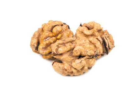 Three fresh walnuts without the shell on white background