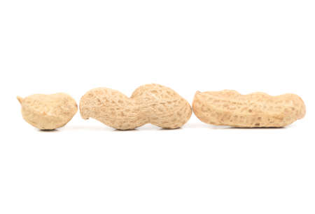 Three peanut inshell with different number of cores on a white background