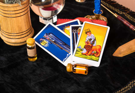Laid out Tarot cards with magical decorations on the table