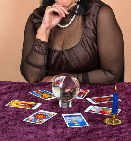 Woman laid on the table the Tarot cards for fortune telling