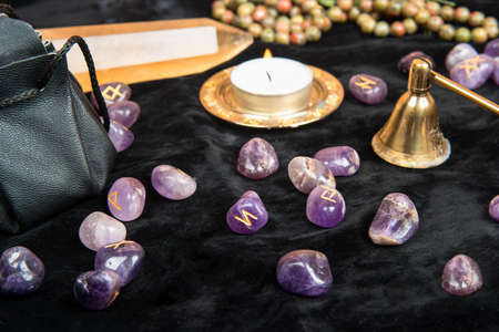 Scattered runes for divination with magical attributes on the table