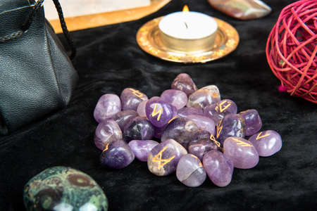 Runes for divination with magical attributes on the table