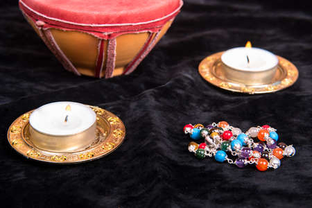 Magical attributes with candles on black background
