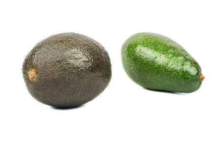Green and black avocados isolated on white background