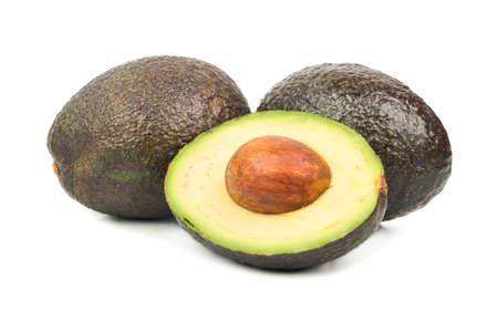 Half avocado Hass with fruit on white background Stock Photo