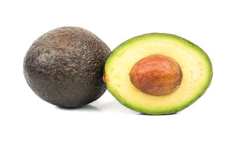 Fresh Hass avocado with half on white background Stock Photo