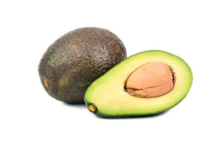 Ripe avocado Hass with half on white background