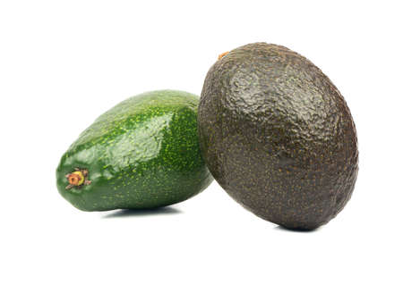 Fresh green and black avocados isolated on white background