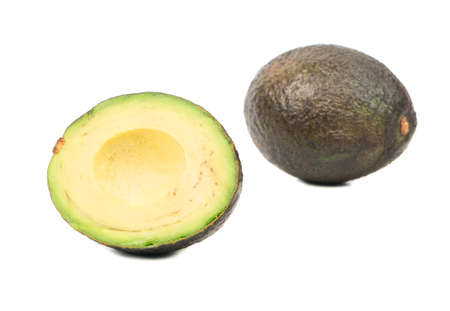 Delicious Hass avocado with half on white background Stock Photo