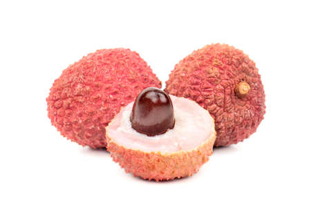 Two lychee fruit in shell half on white background