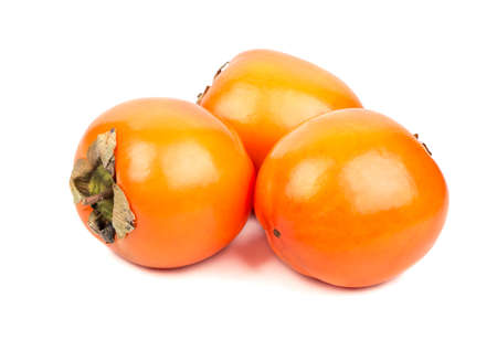 Three delicious fruit persimmons on white background Stock Photo