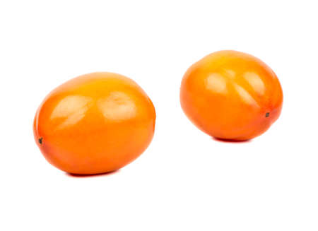 Two ripe persimmon fruits on a white background