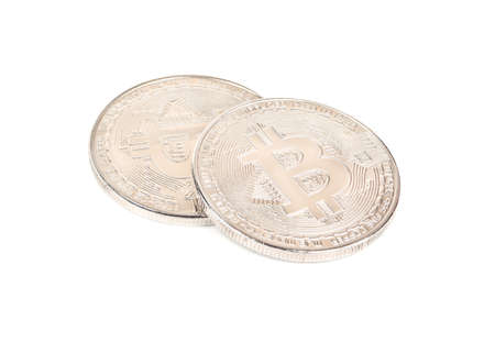 Two silver coins bitcoin on a white background