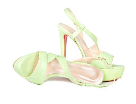 Leather green womens sandals with high heels on white background