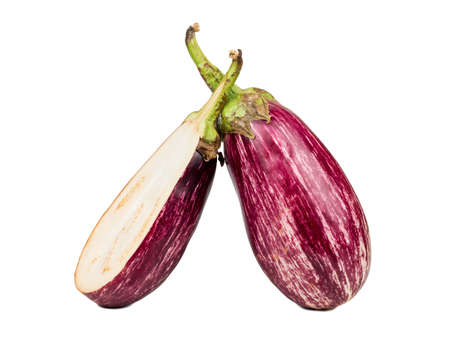 Raw purple eggplant with half on white background
