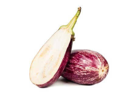 Raw purple eggplant with half on white background