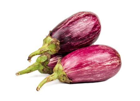Three raw purple eggplant on white background Фото со стока