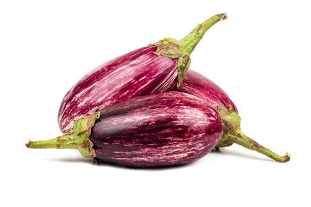 Three fresh purple eggplant on white background Фото со стока