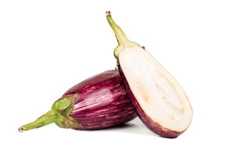 Fresh purple eggplant with half on white background