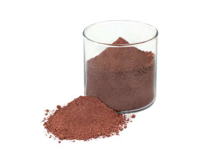 Brown chemical powder in glass on white background