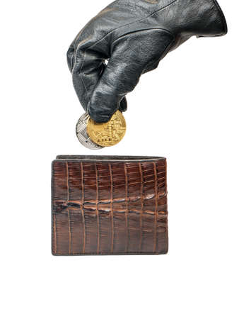 Thief in gloves pulls out a silver and gold coin bitcoin of their wallet on white background Stockfoto