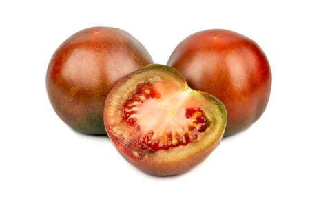 Two kumato tomatoes with a juicy half on a white background 免版税图像