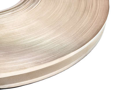 Part of round coil metal tape on white background close-up