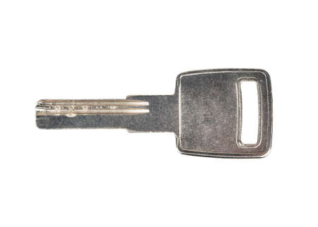 Metal door key isolated on white background, top view 免版税图像