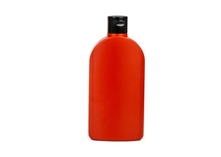 Red plastic bottle isolated on white background Archivio Fotografico