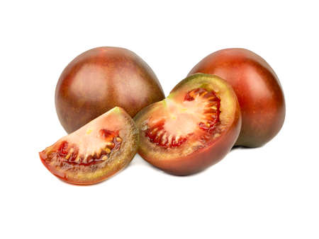Fresh kumato tomatoes with slice and half on white background
