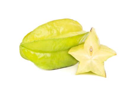 Fresh carambola fruit with juicy half on white background Standard-Bild